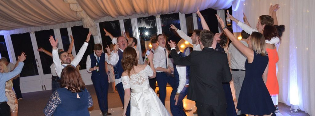 guests dancing to wedding DJ at Keythorpe Manor