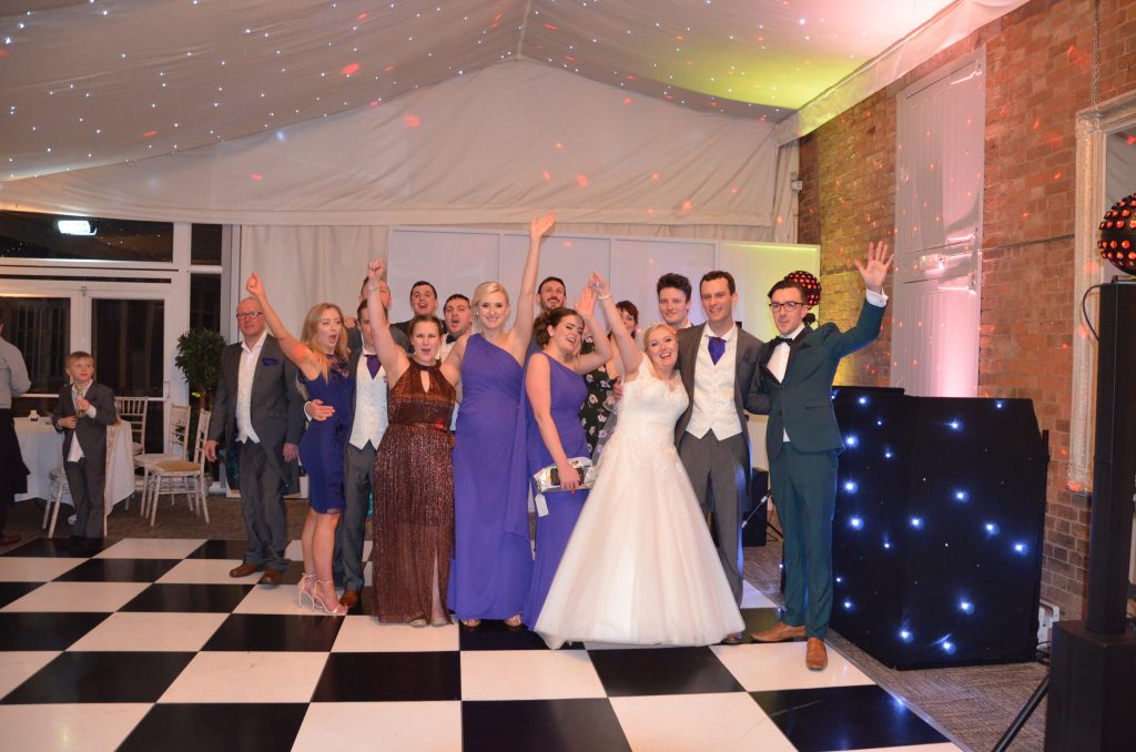 Wedding DJ Jack with the bride, groom and their guests!