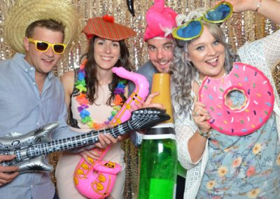 wedding guests having fun in open air photo booth