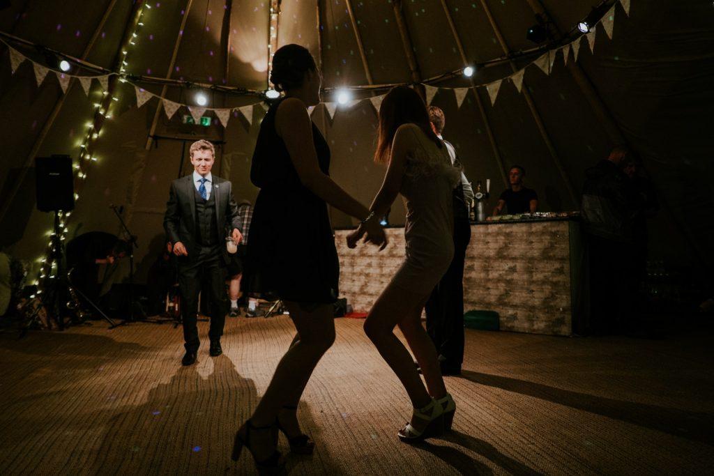 wedding guests dancing tipi wedding dj