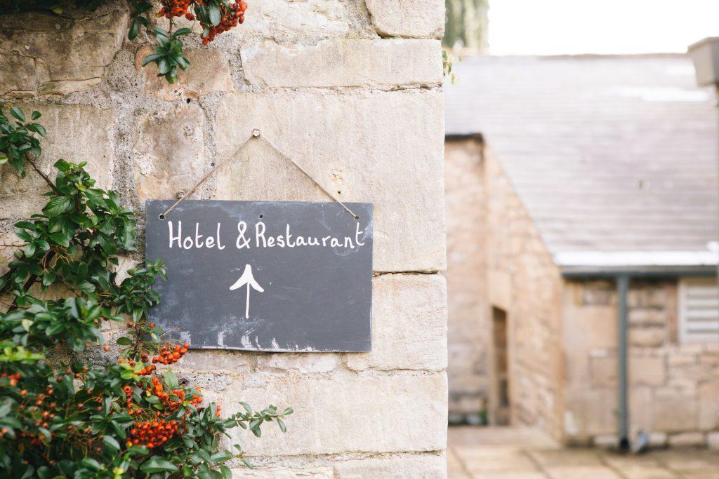 wedding venue hotel sign brick wall