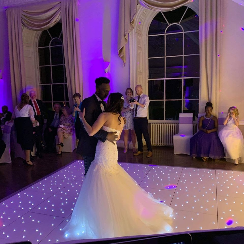Bride and Groom's first dance on wedding day with white LED dance floor