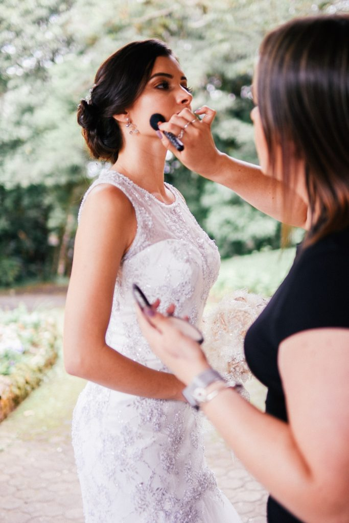 Bride getting ready with make up artist