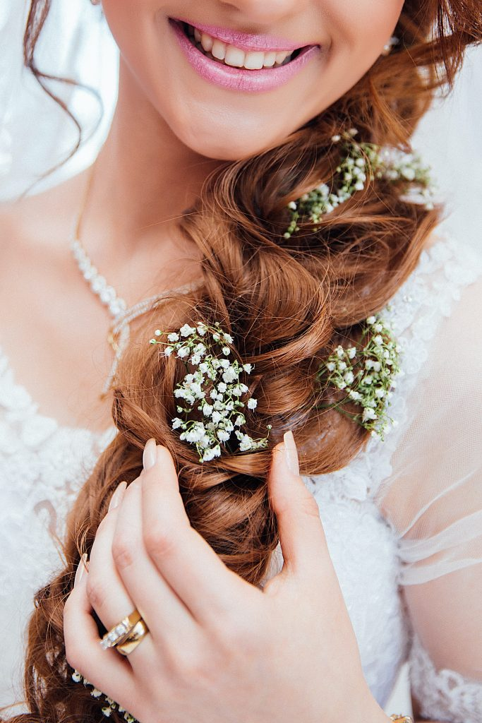 Bride with flowers in hair and pink lipstick