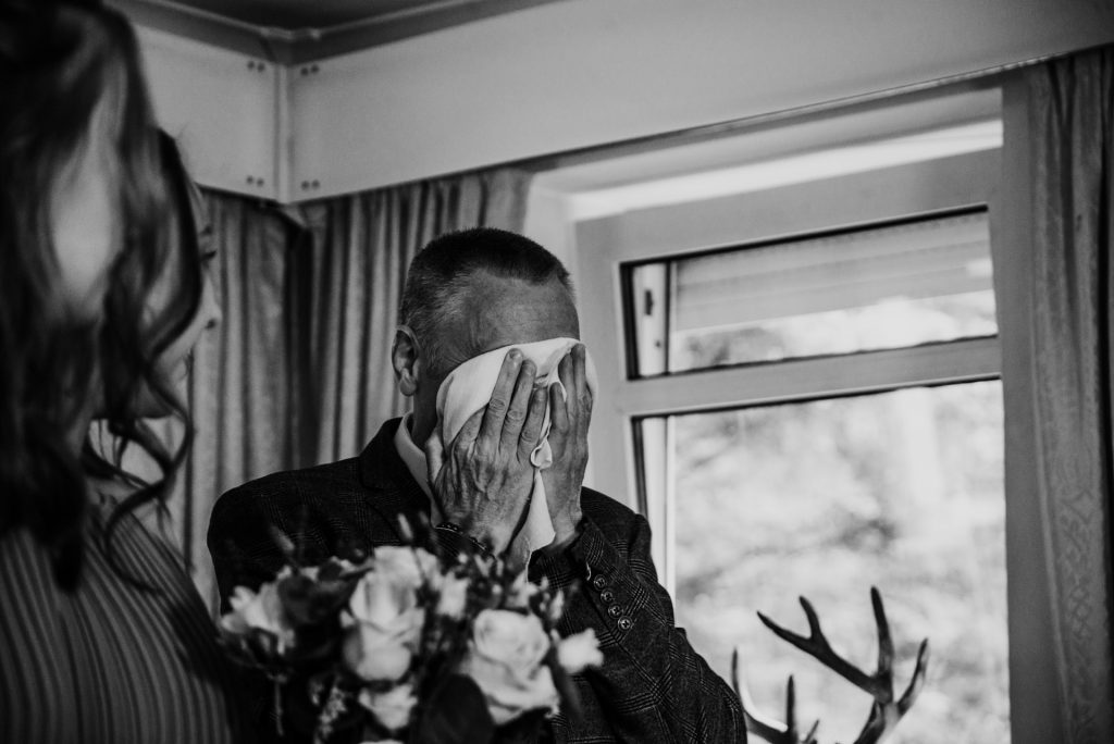 Father of the Bride cries during wedding ceremony