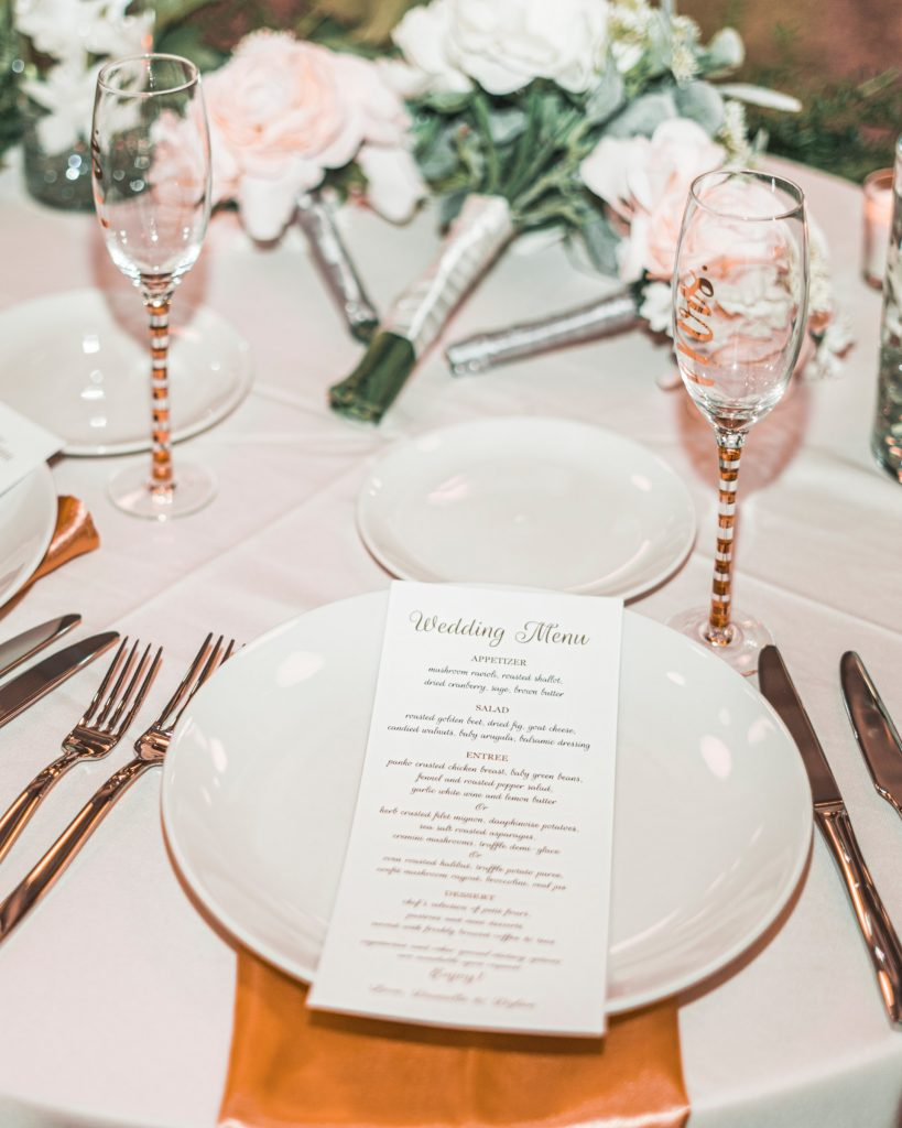 Wedding table setting with wedding breakfast menu