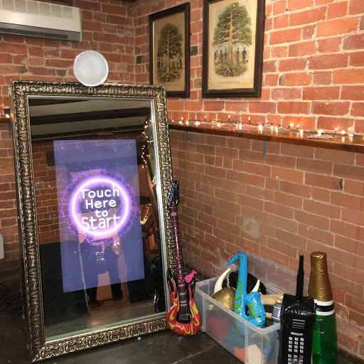 Magic mirror with props at farmhouse wedding
