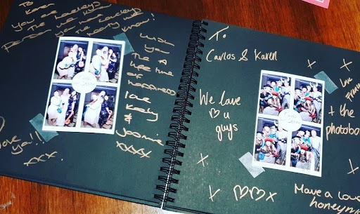 Black photo booth guest book at a wedding