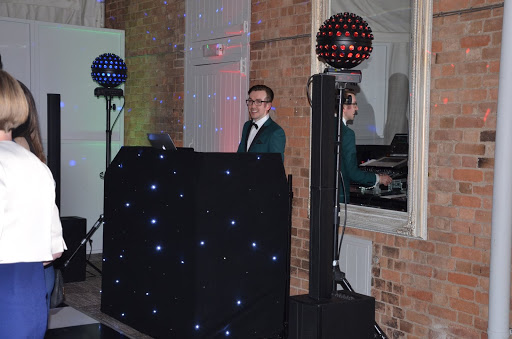 Wedding DJ dressed in suit and tie