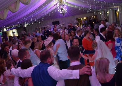 Wedding guests dancing on white LED dance floor in Nottingham