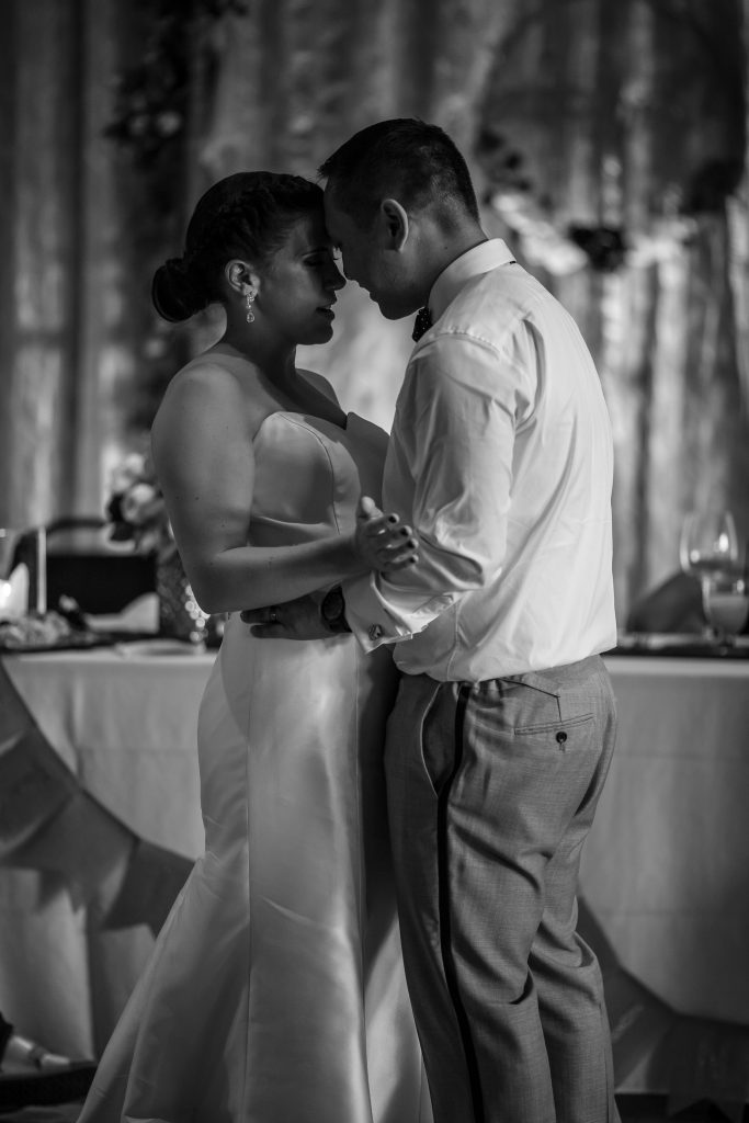 bride and groom first dance with wedding dj
