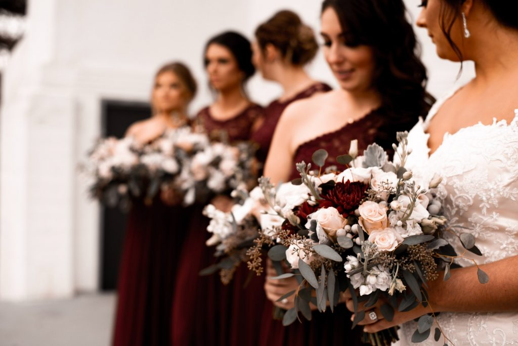 Colour co-ordinated bridesmaid dresses and brides flowers
