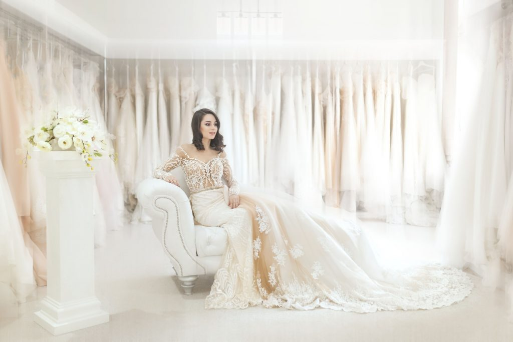 Bride relaxing at wedding dress boutique