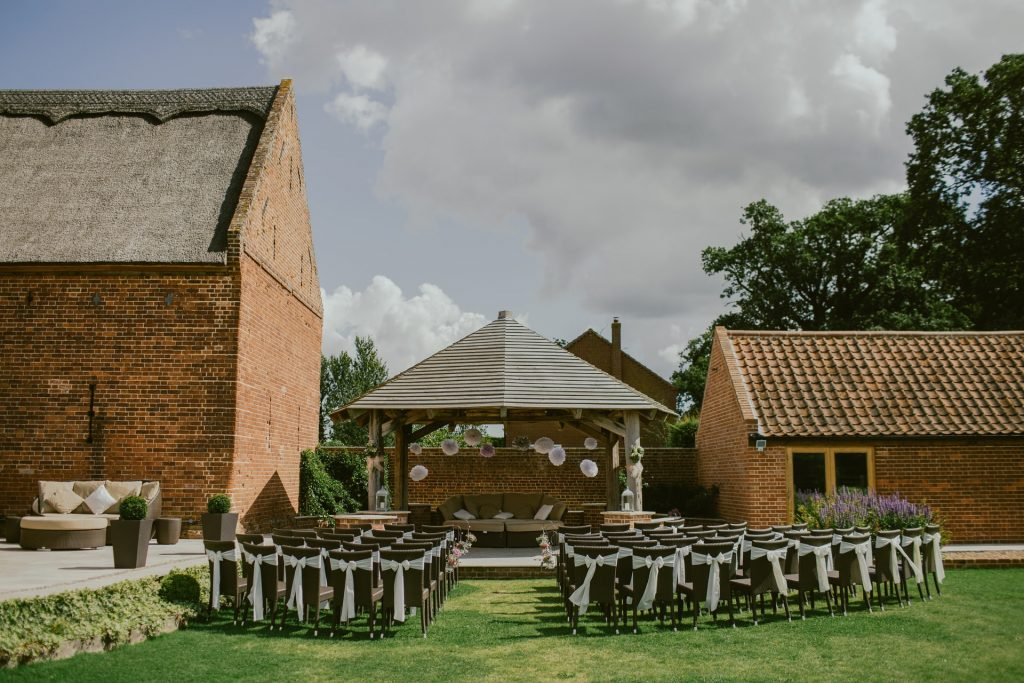 Chairs organised for outdoor wedding ceremony