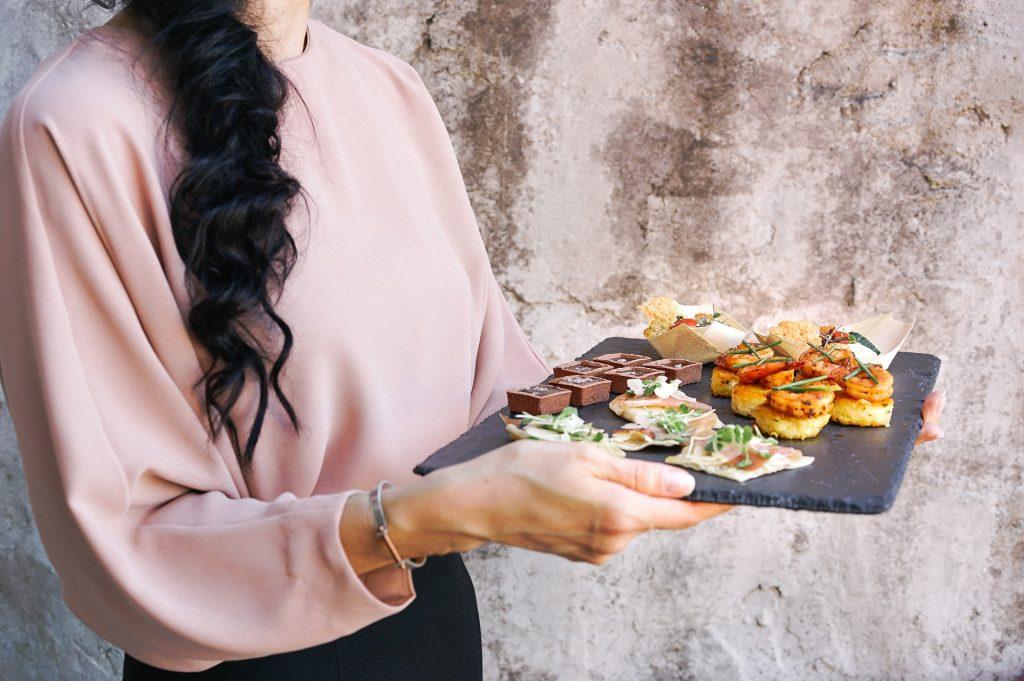 Waitress holding tray of canapes at wedding