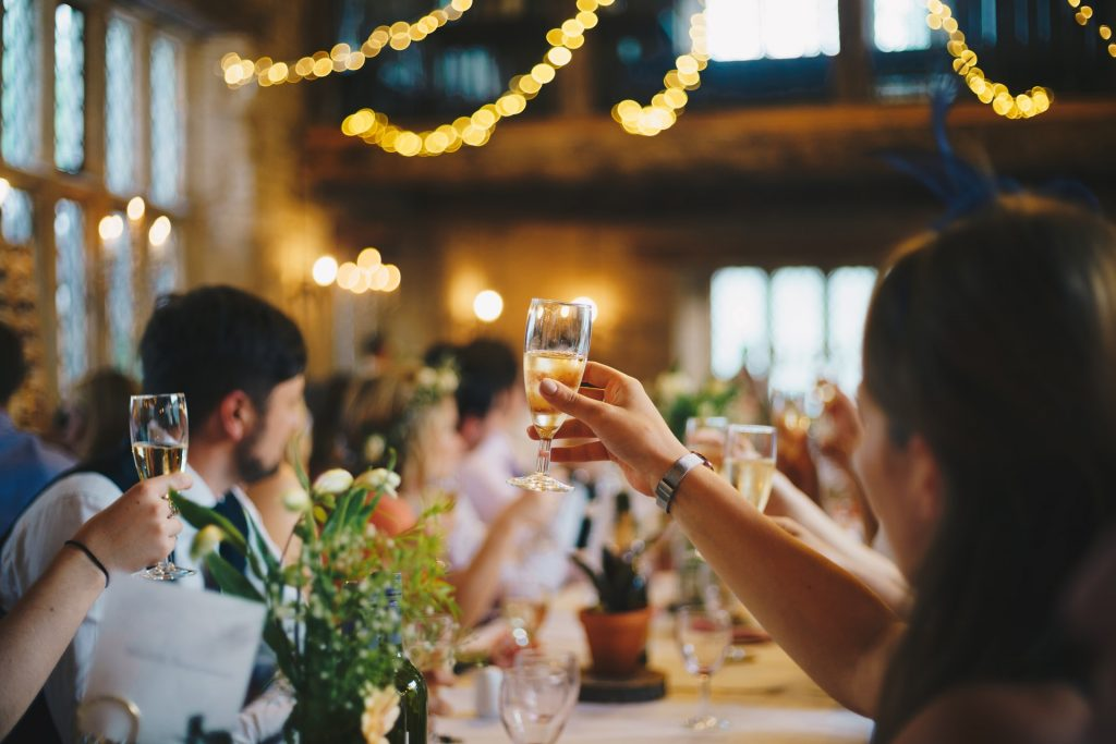 Guests raise glasses of champagne for wedding toast