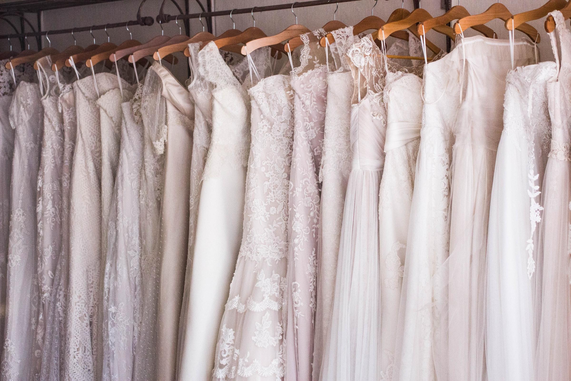 Rail of wedding dresses in wedding dress boutique