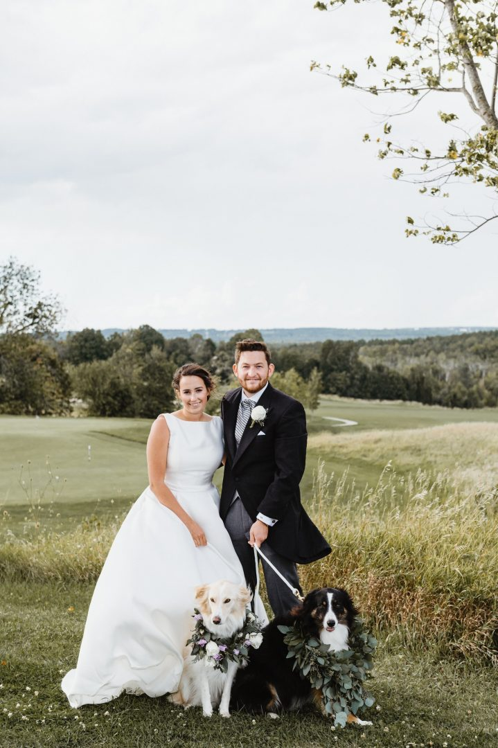 Bride and Groom with Dogs Near Woodland