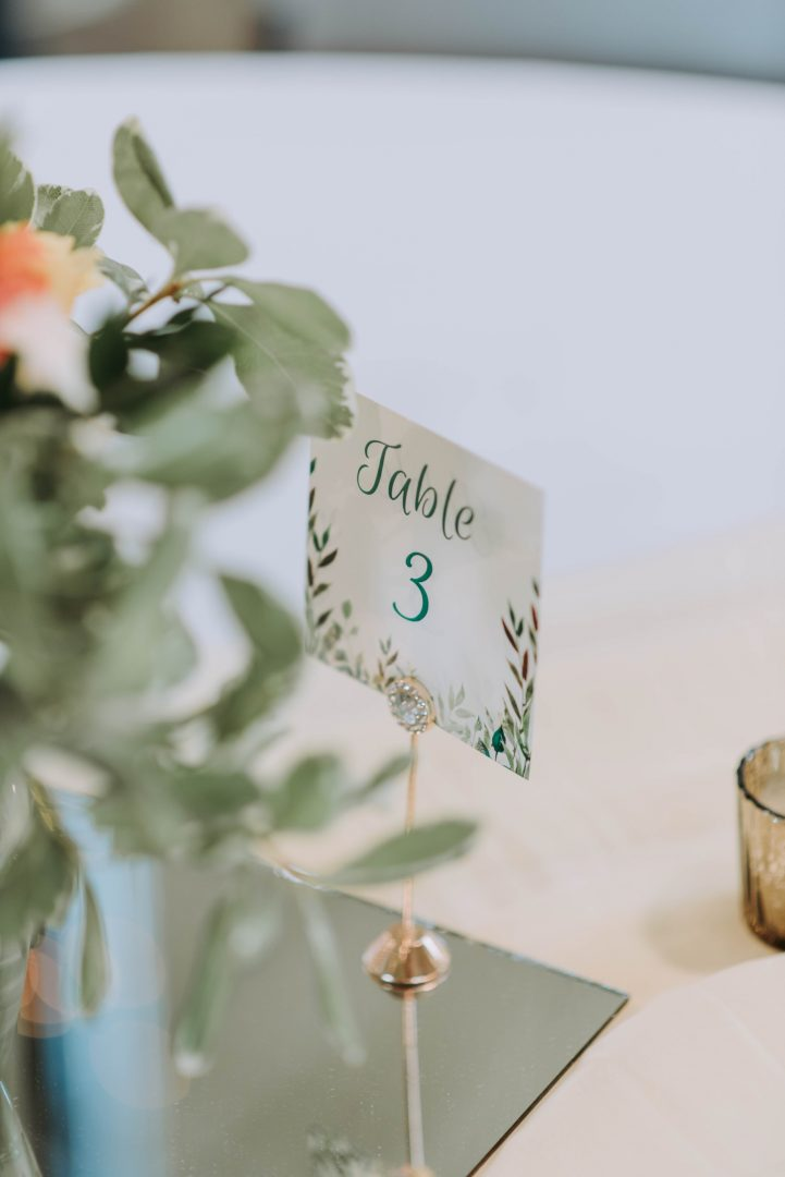 Wedding table setting with mirror and table number