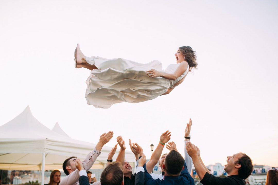 Bride flies through the air on wedding day
