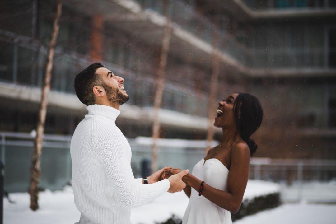 Wedding couple dance in snow scene