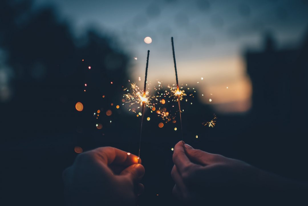 Couple with sparklers in early evening