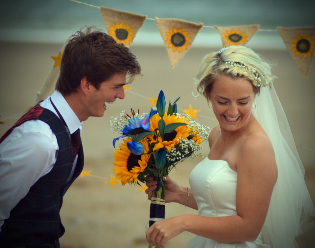 Couple getting married outdoors on the beach