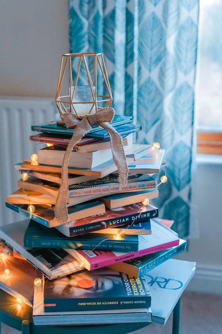 Tall pile of books with geometric topper and hessian rustic ribbon