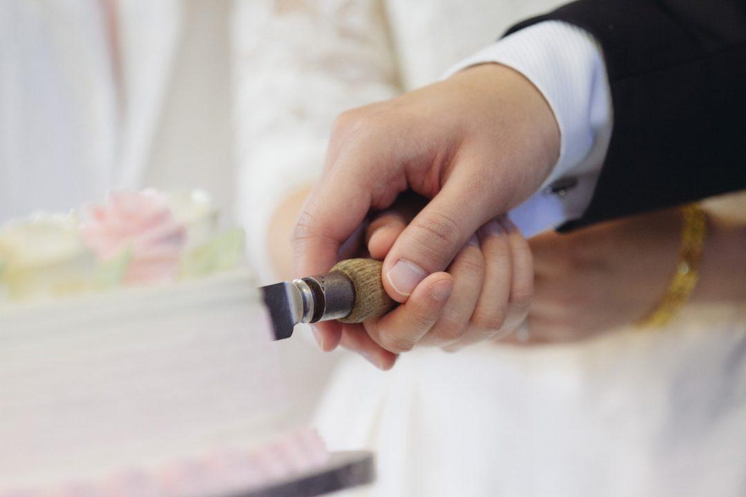 Bride and Groom Cutting Wedding Cake on Wedding Day