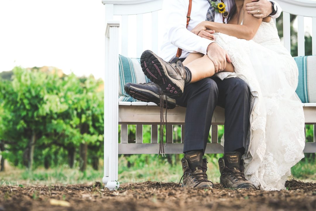 Bride and Groom wearing walking boots on wedding day