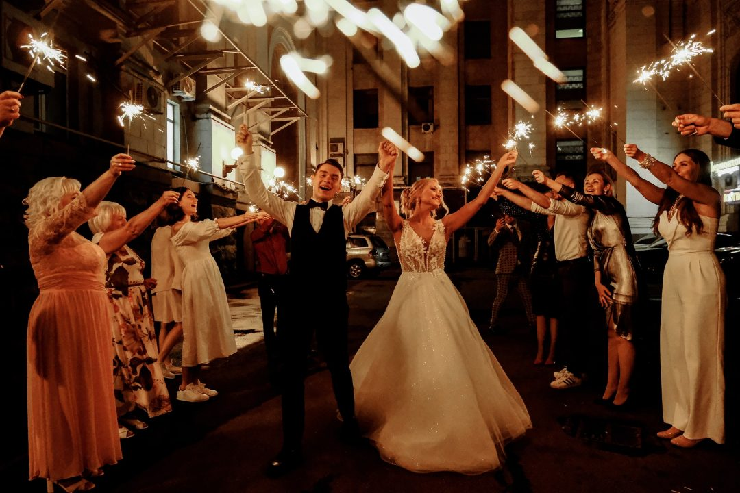 Bride and Groom - guests with sparklers outside at night