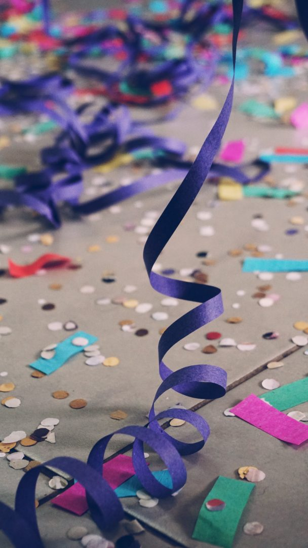 Floor covered in confetti and ribbons