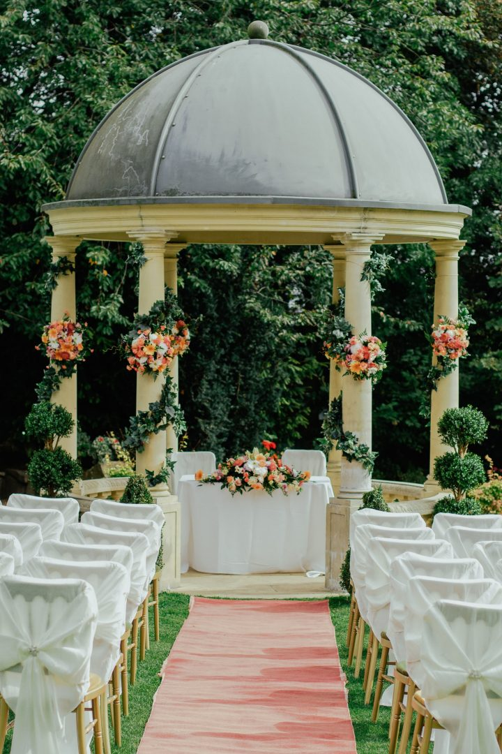 Outdoor wedding ceremony setup with gazebo