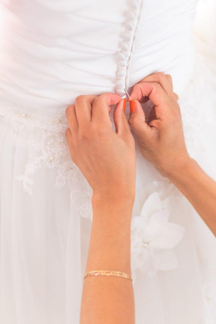 Elegant wedding dress details - buttoning up