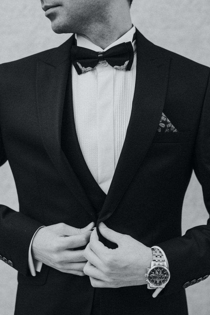 Groom in black tie tuxedo before wedding