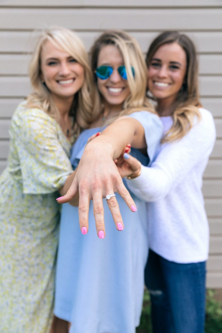 Maid of honour and bridesmaid share brides engagement ring