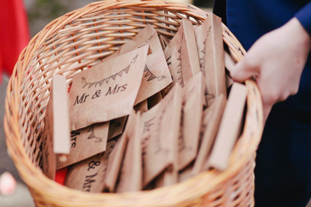 Rustic basket of confetti in kraft envelopes