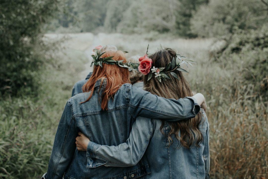 Flower girls on wedding day in denim jackets