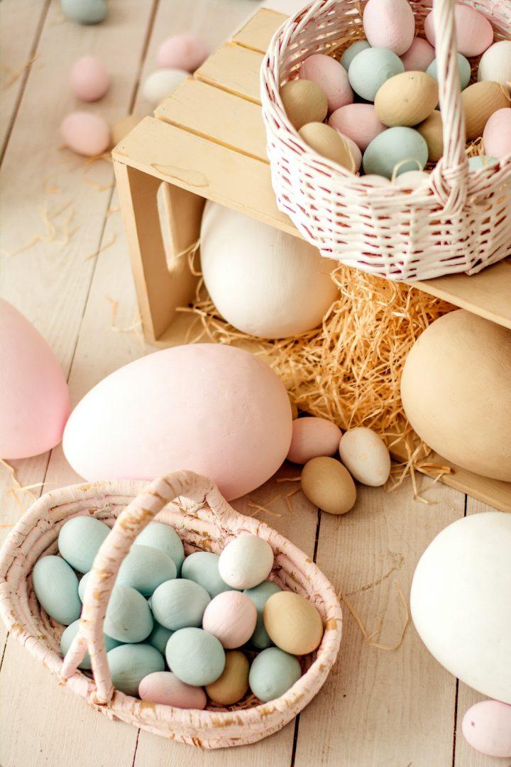 Easter egg hunt basket filled with pastel eggs