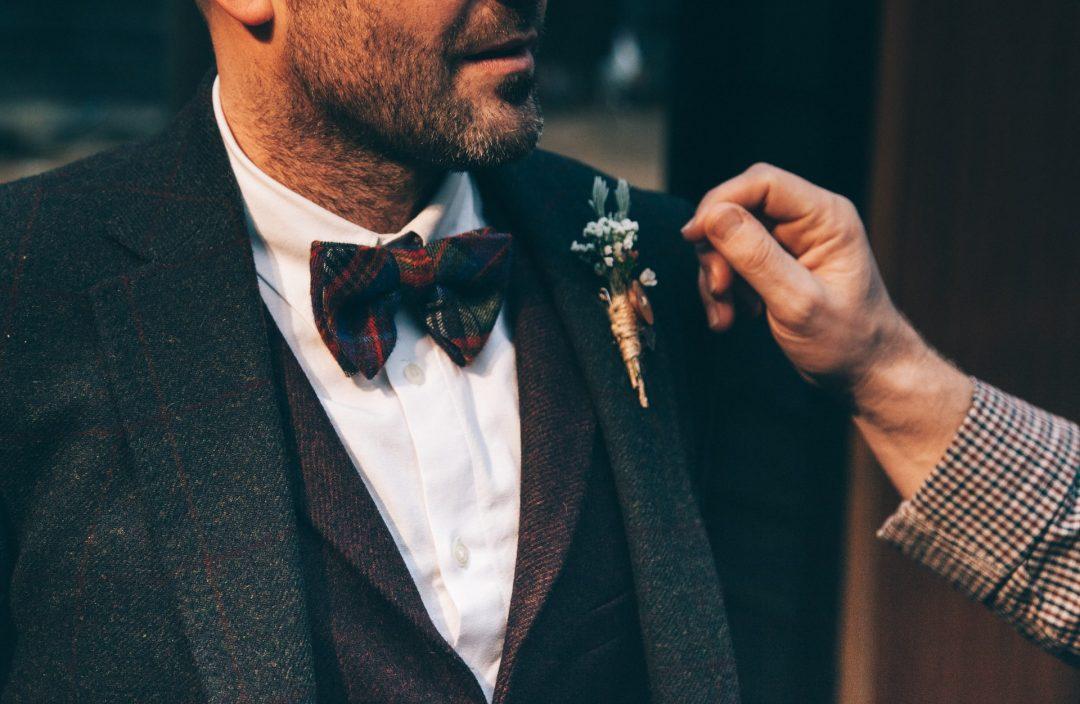 smart looking groom in stylish wedding suit before wedding ceremony
