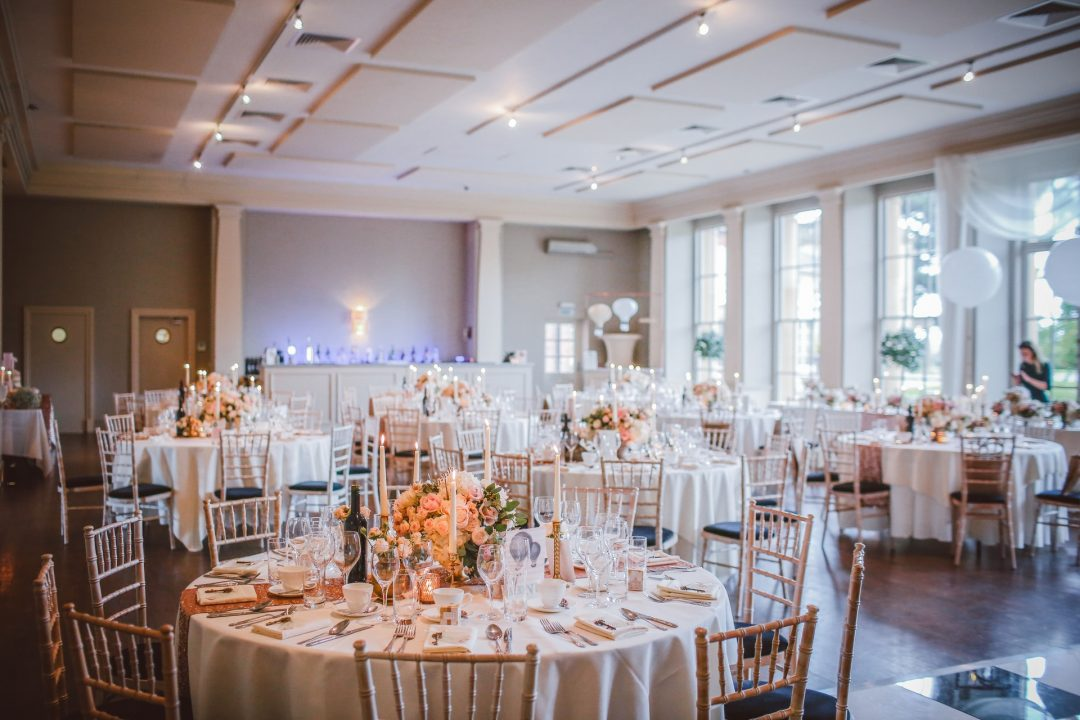 Elegantly styled wedding breakfast setting in wedding venue