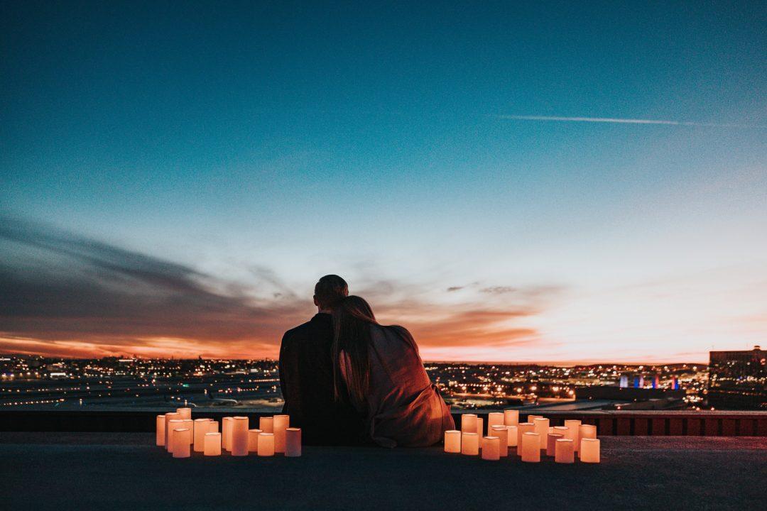 Recently engaged couple share romantic candlelit evening