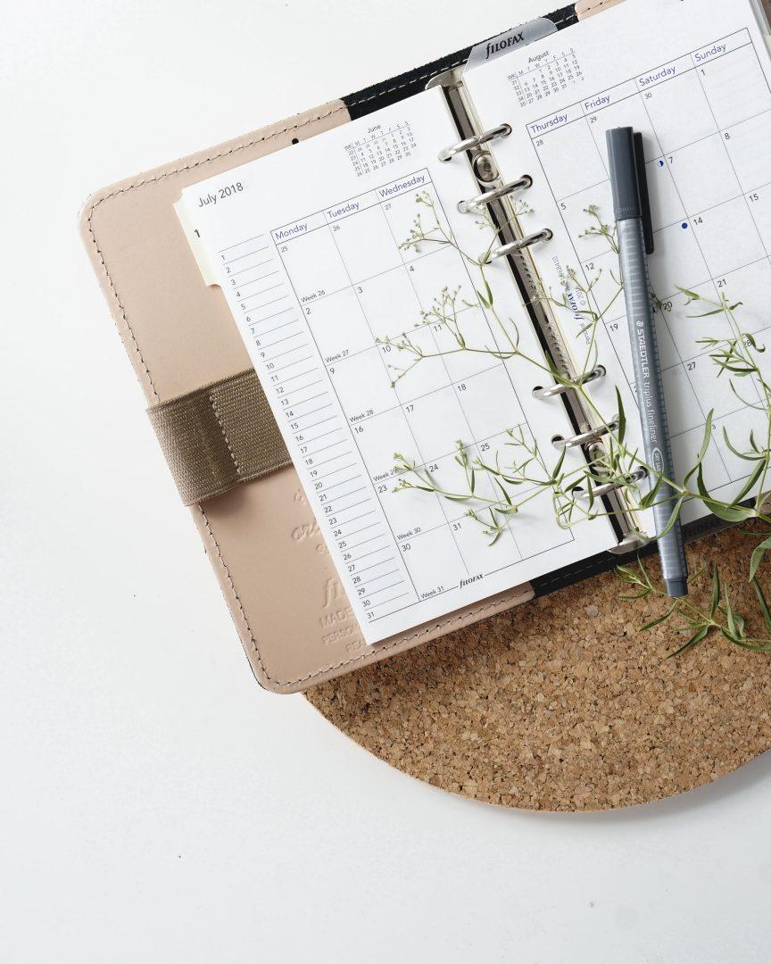 Wedding planner open diary on desk